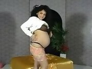Preggy latin girl caresses her tits