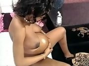 Preggy black slut plays with pussy