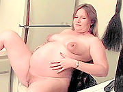 Blonde preggo dildo drilling her pierced pussy in the kitchen
