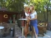 Lezzie spoils pregnant girl outdoor